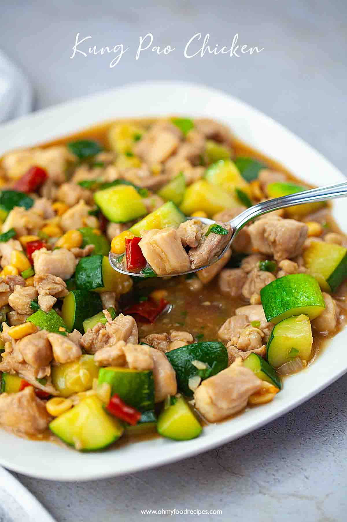 Chinese Kung pao chicken dish with a spoon