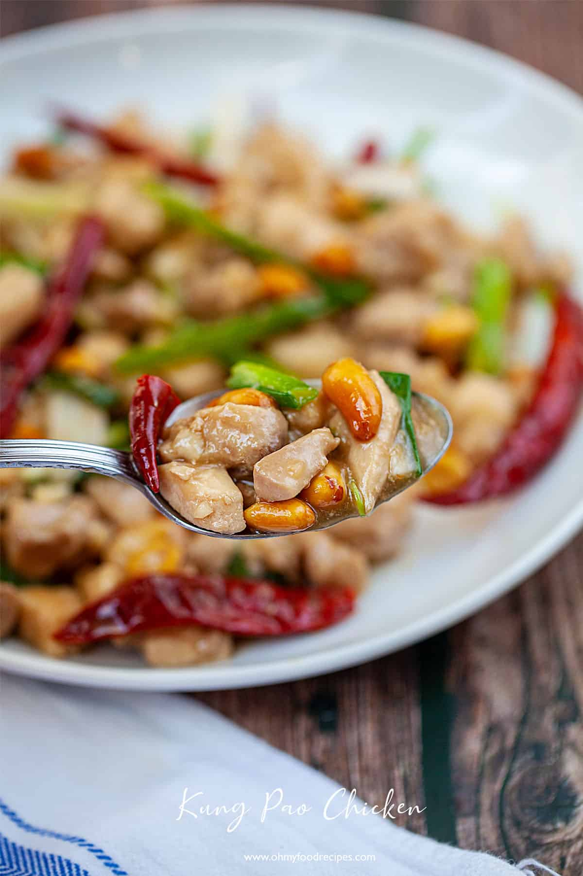 kung pao chicken on a sliver spoon