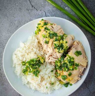 Cantonese white cut chicken with rice serve with ginger scallion sauce