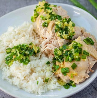 Sliced Boiled White Cut Chicken serve with rice and ginger green onion sauce