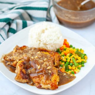 Chicken chop with black pepper sauce serve with rice and mixed vegetable
