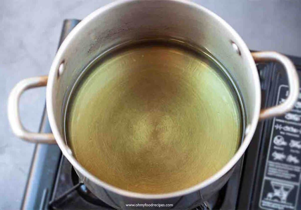 heat up oil in the pot over the stove