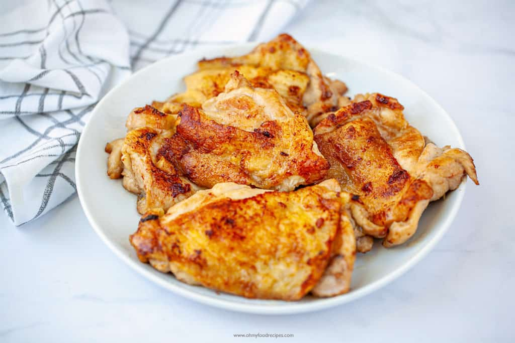 pan fried chicken chops on a white plate