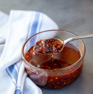 Xo sauce scoop on a silver spoon