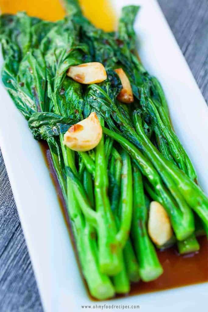 garlic yu choy sum on a white long plate