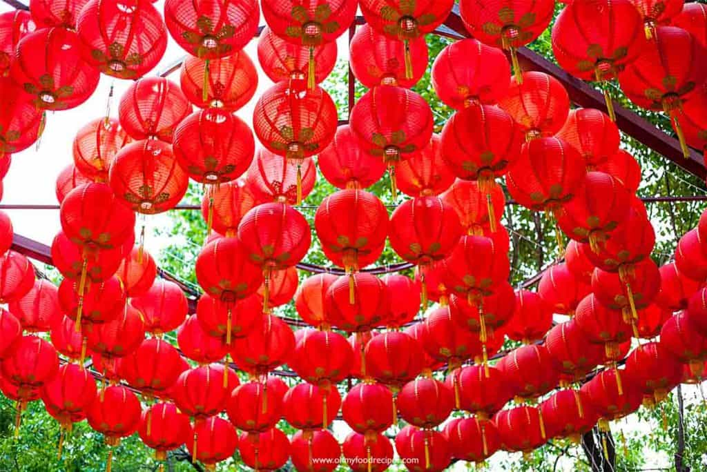 Chinese new year red lanterns hang on trees