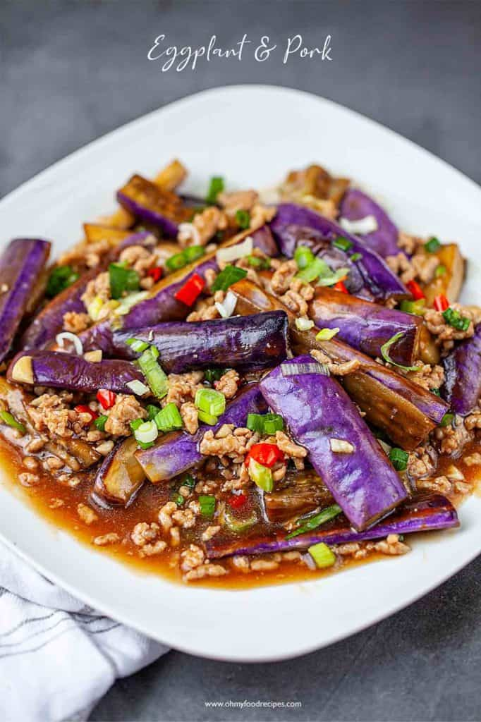 Chinese eggplant stir fry with minced pork on and white plate