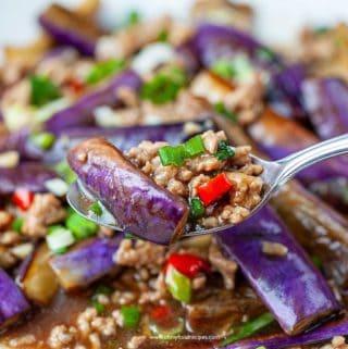 stir fry eggplant with pork on a silver spoon