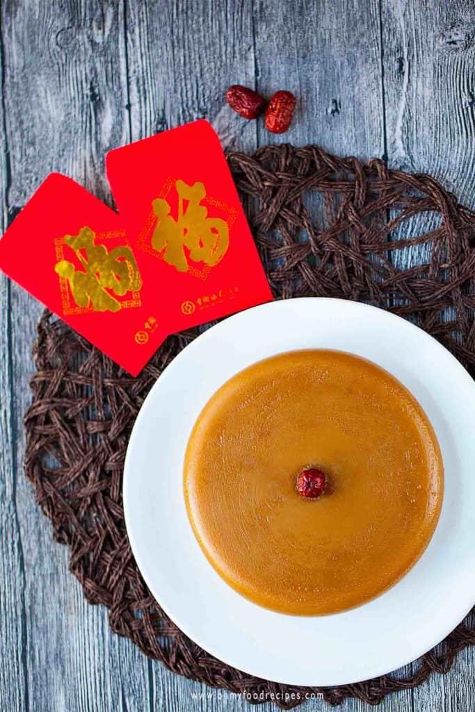Nian gao with jujube on the top on a white plate