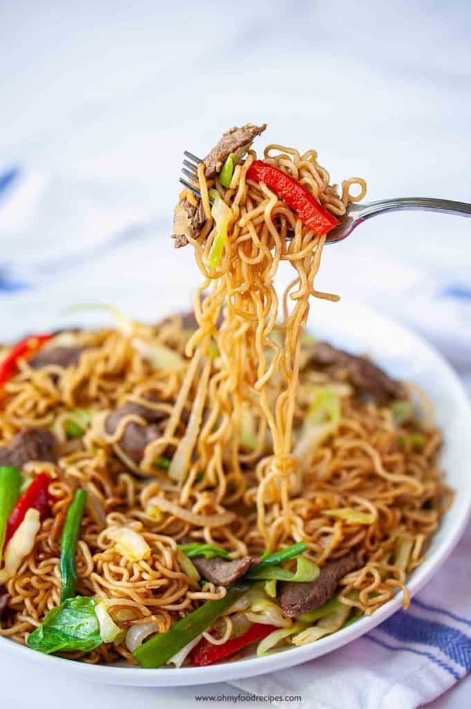 stir fry instant noodles on a silver fork
