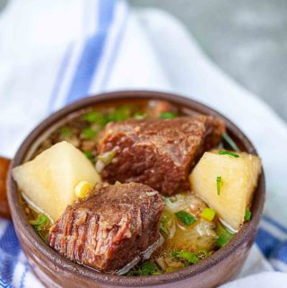 braised beef and radish in a brown pot