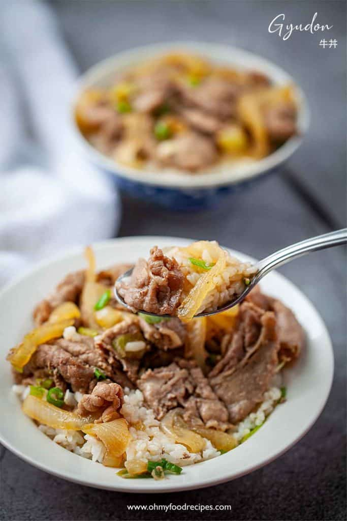 Gyudon Japanese beef bowl on a silver spoon