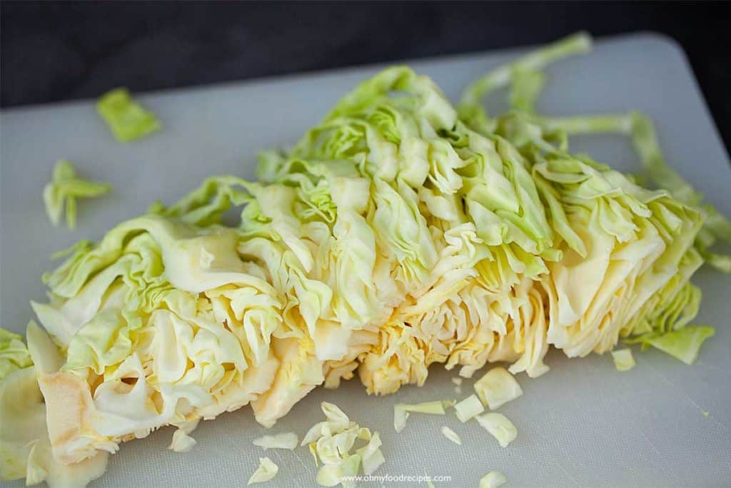 cut cabbage on a chopping board