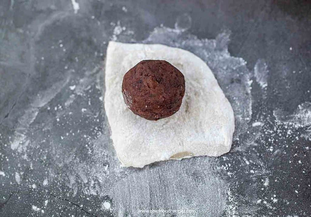 red bean ball on a flour dough