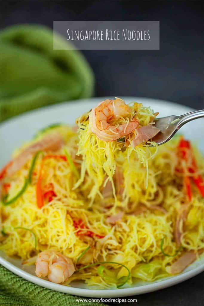Singapore rice noodles on a fork with shrimp and ham sing jau chow mai