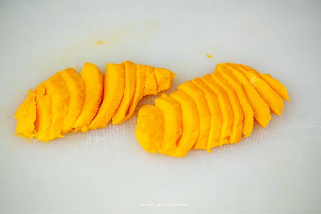 sliced mango on a chopping board