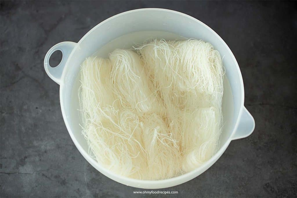 soaking rice vermicelli noodles in a bowl