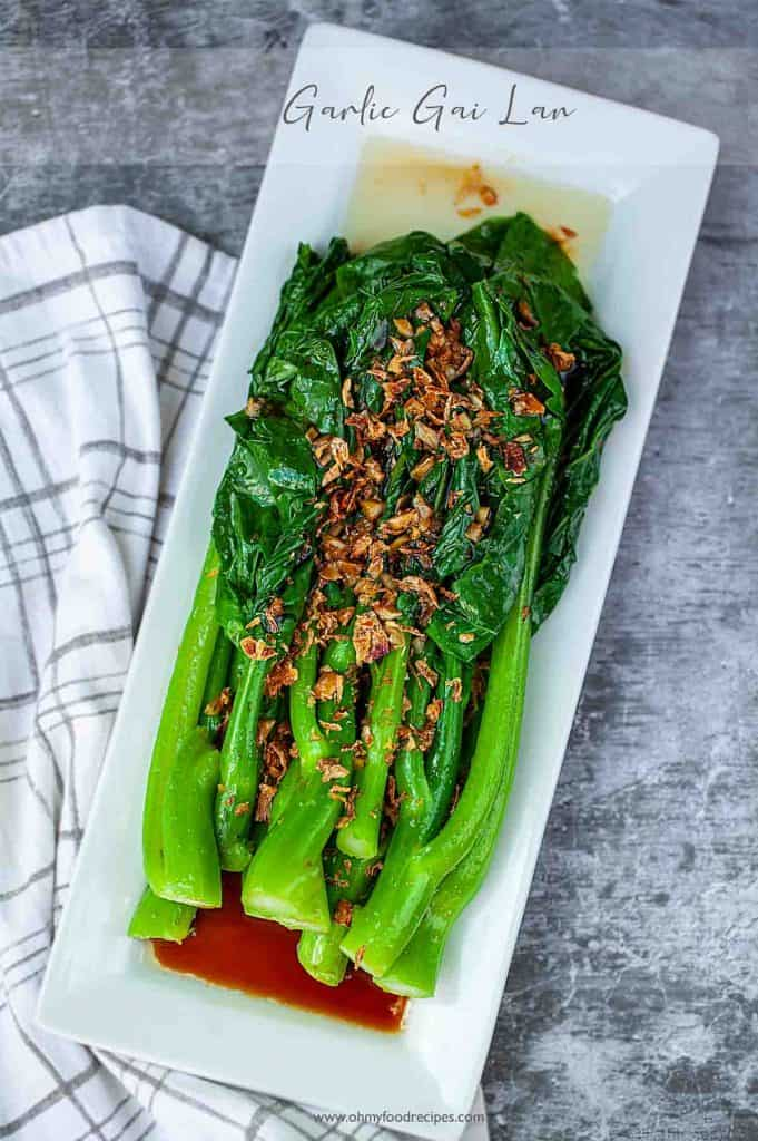Chinese broccoli with oyster sauce in a rectangle plate