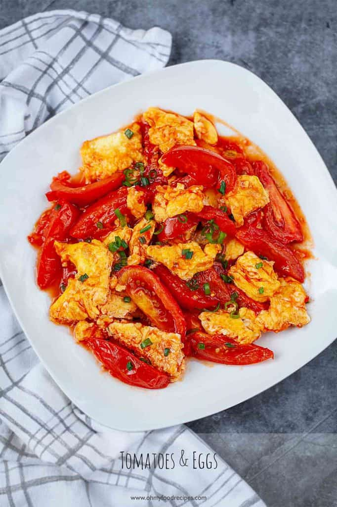 tomato egg stir fry on a white plate