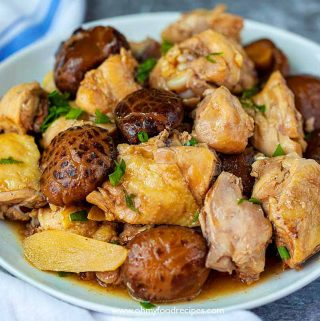Braised Chinese mushroom and chicken on a plate with a towel