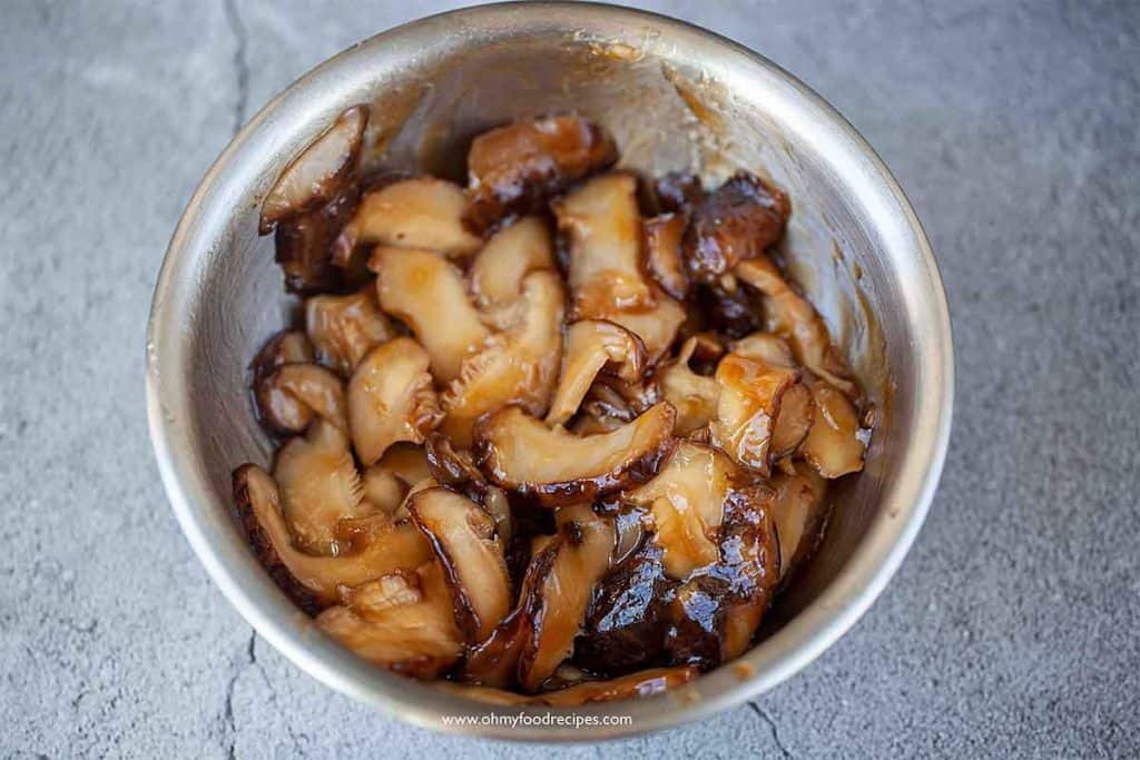 marinated mushrooms in a sliver bowl