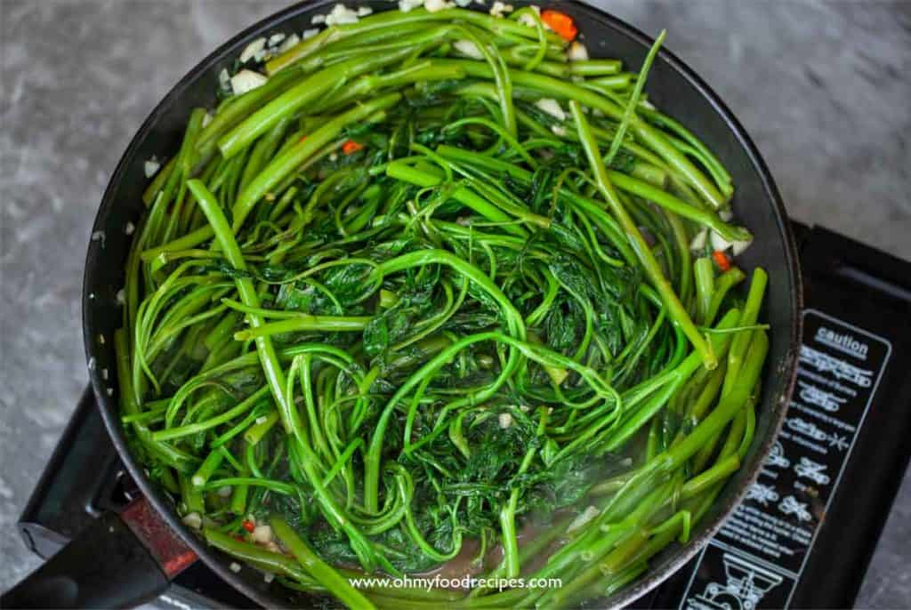stir fry ong choy with shrimp paste in the pan
