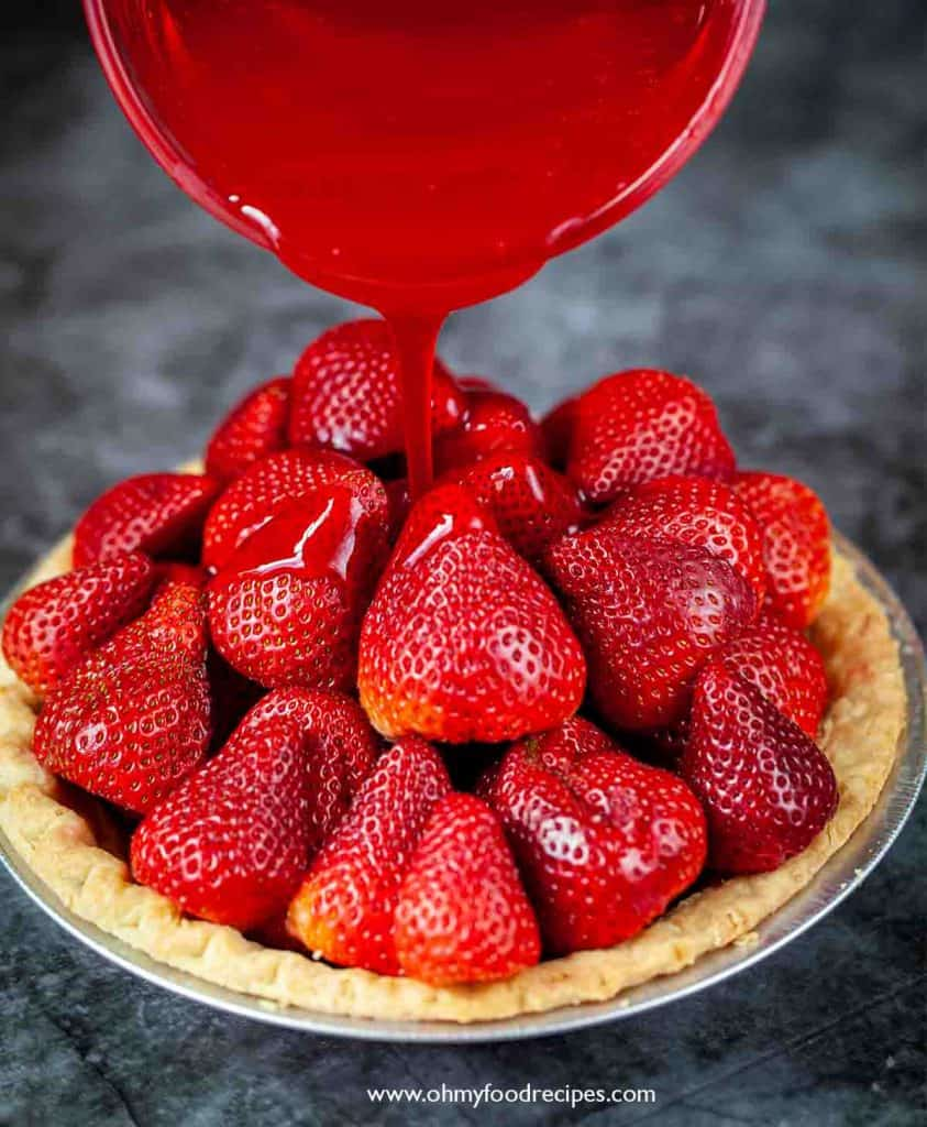 glaze pouring on strawberries