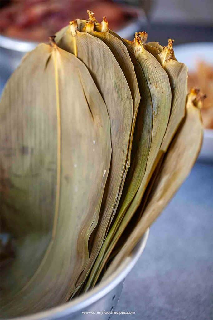 soaked bamboo leaves in a drainer