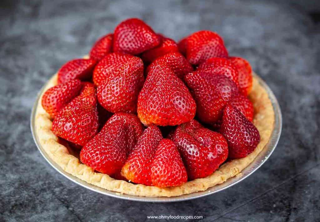 fresh strawberries fill up the pie crust
