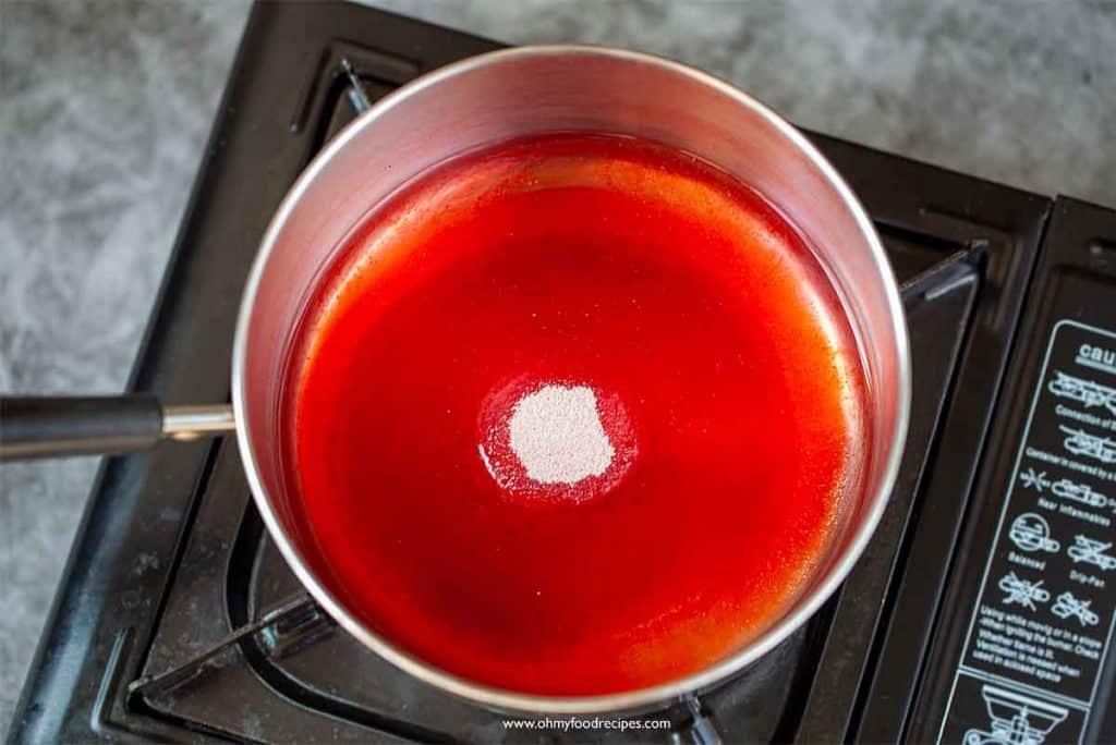 strawberry jello glaze ingredients in a pot