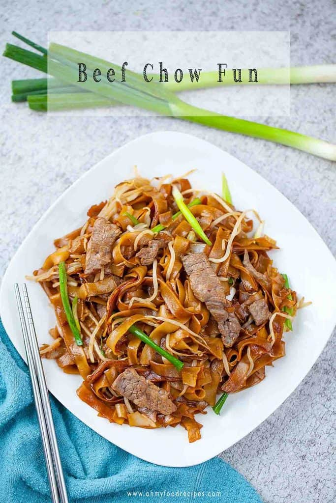 beef chow ho fun top view with sliver chopsticks