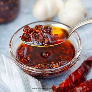chili oil scooping on a sliver spoon
