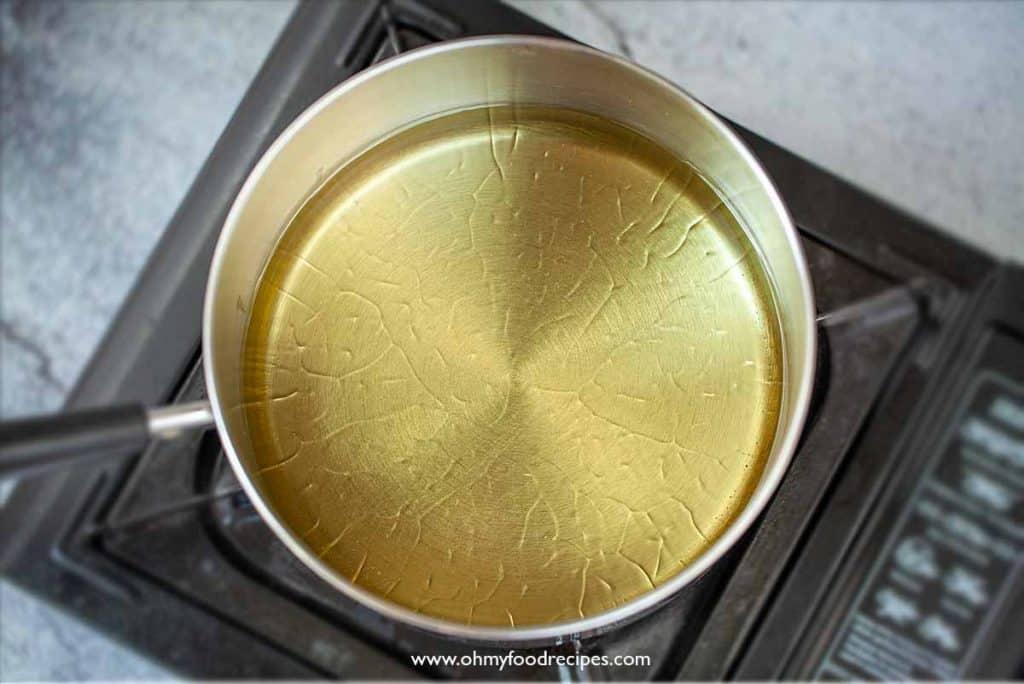 heat up oil in a pot