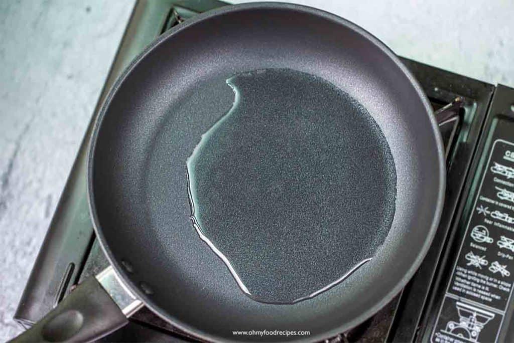 vegetable oil heating on the pan