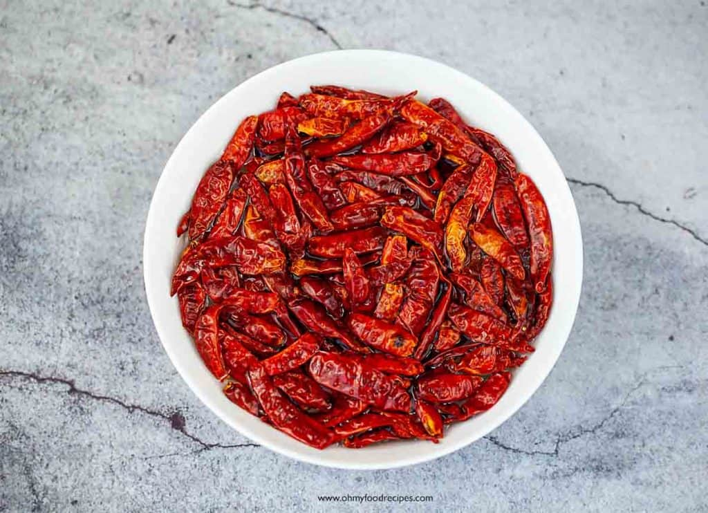 dried chili peppers soak in a bowl
