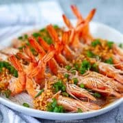 steamed garlic shrimp with vermicelli noodles on a plate with a towel