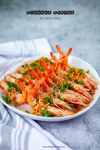 steamed garlic shrimp with vermicelli noodles on a white plate