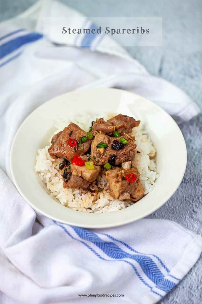 Chinese steamed spareribs with black bean on a bowl of rice