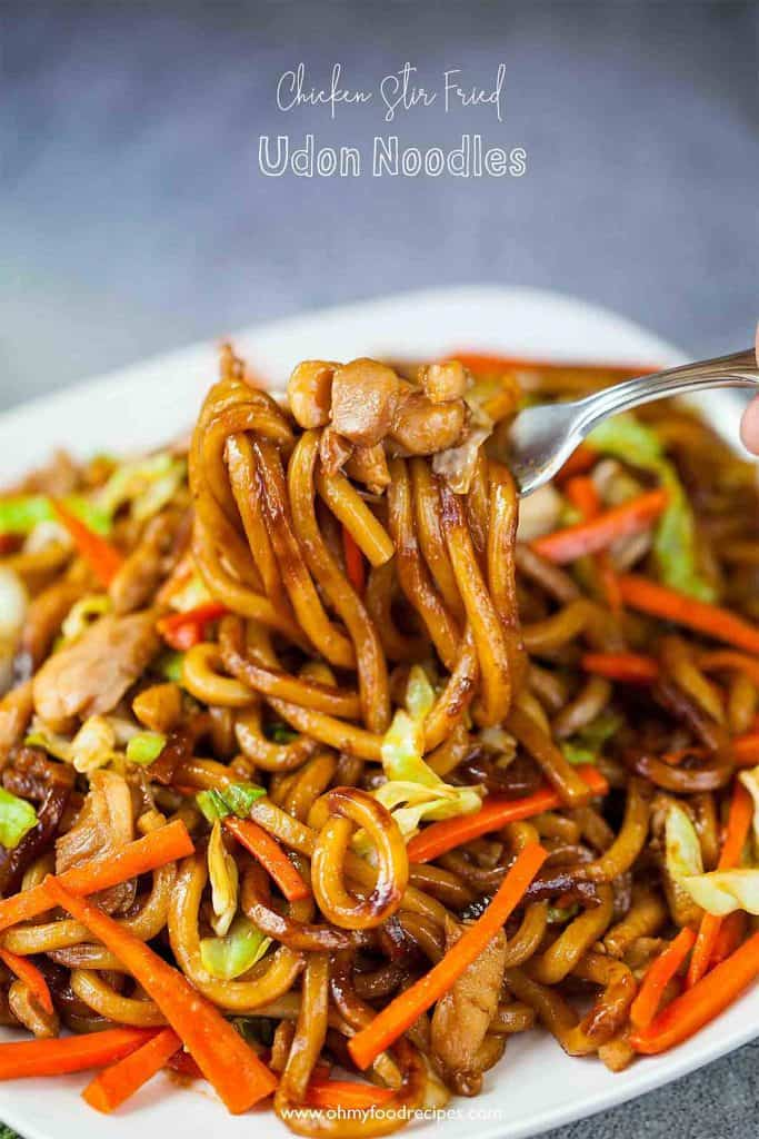 stir fry chicken udon noodles on a fork