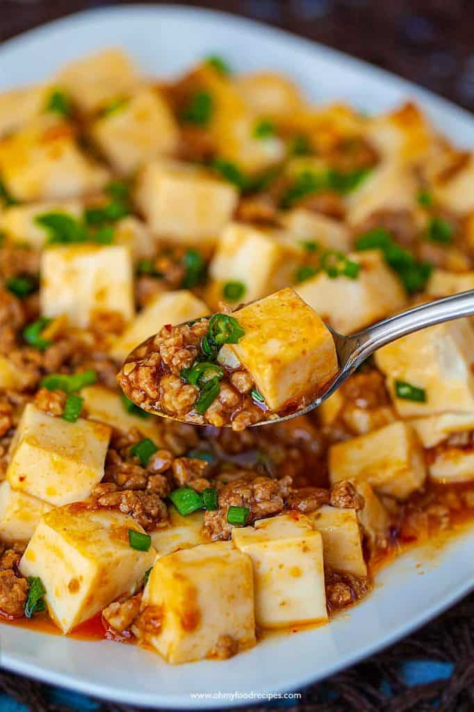 authentic mapo tofu on a sliver spoon
