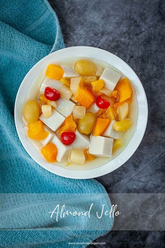 Almond jelly in a white bowl with mixed canned food top view