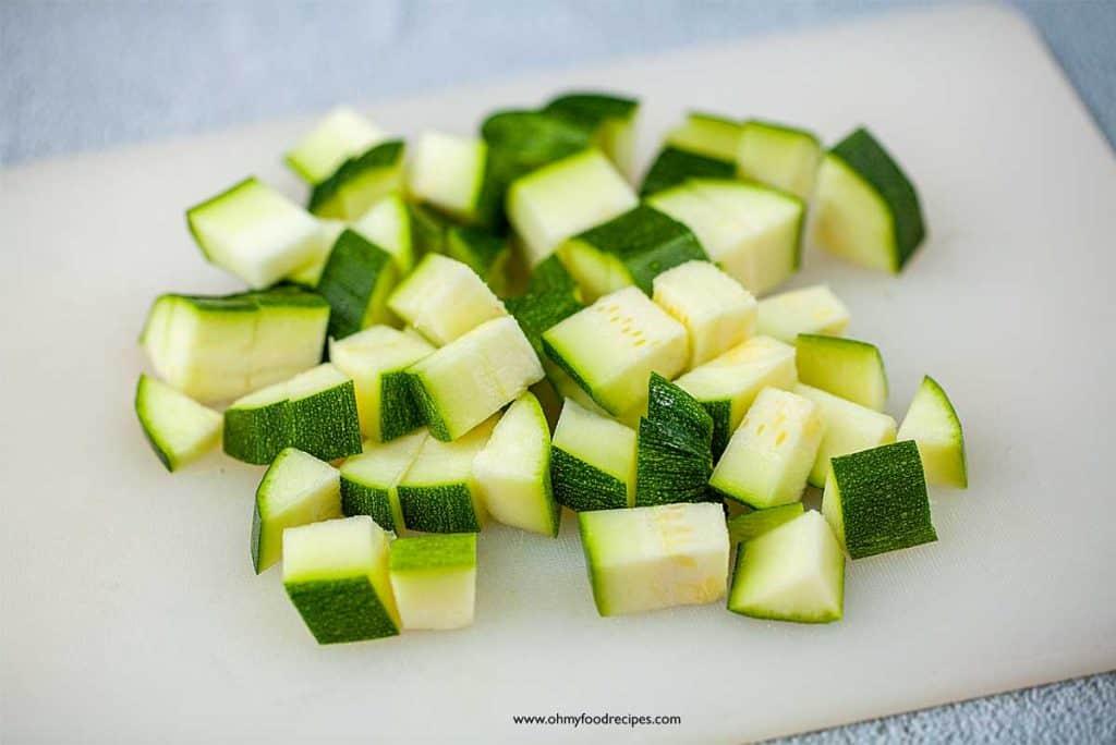 cut zucchini on chopping board