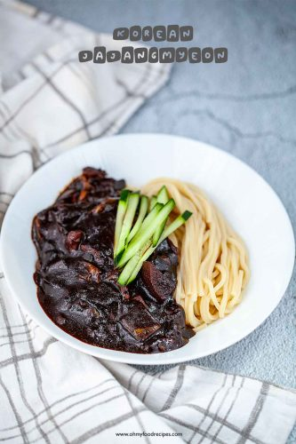 Korean jajangmyeon in a bowl with a checked towel