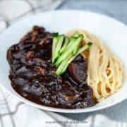 Korean black bean noodles top with cucumber stirps