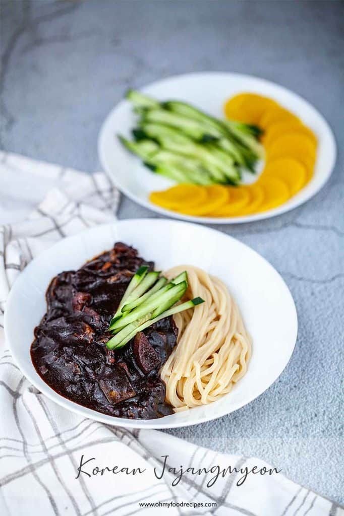 Jajangmyeon with danmuji and cucumber on a side