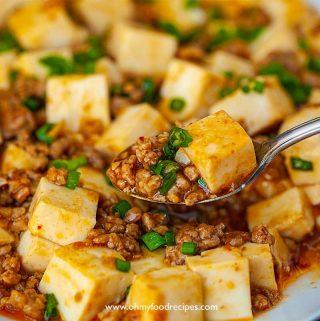 mapo tofu scoop on a sliver spoon