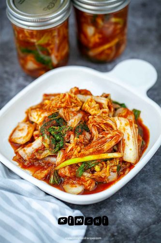 kimchi napa cabbage on a plate and some in jars