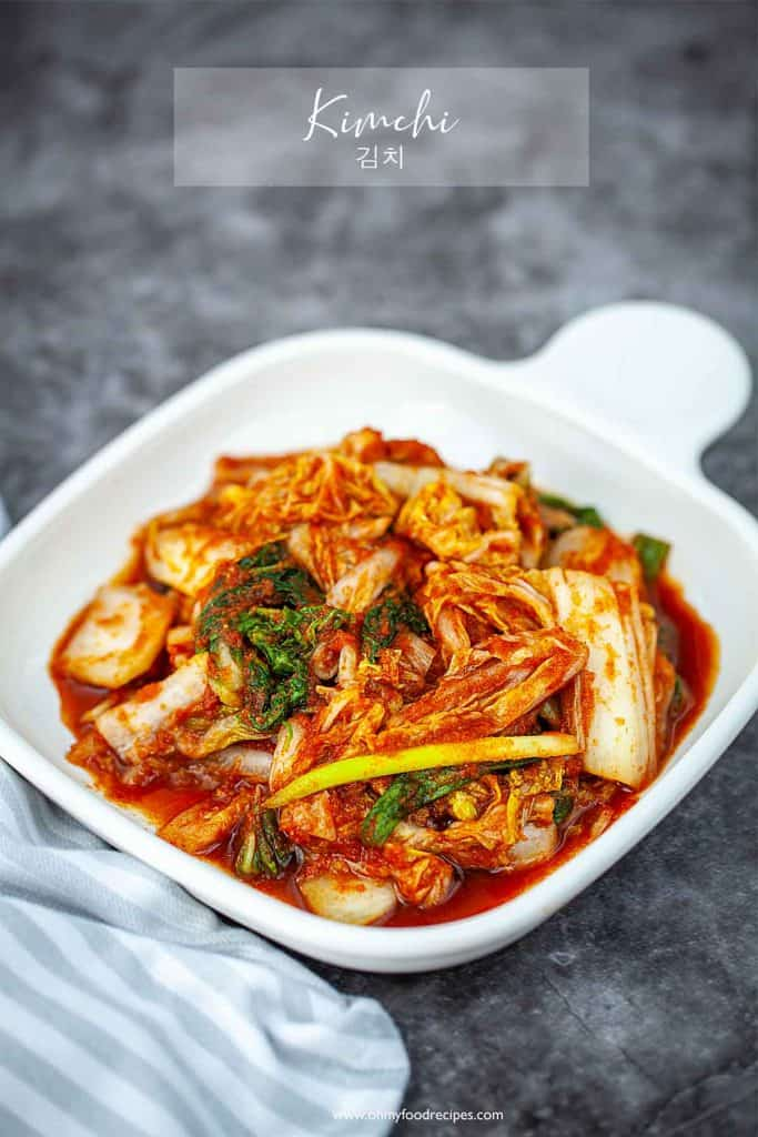 kimchi on a square white plate