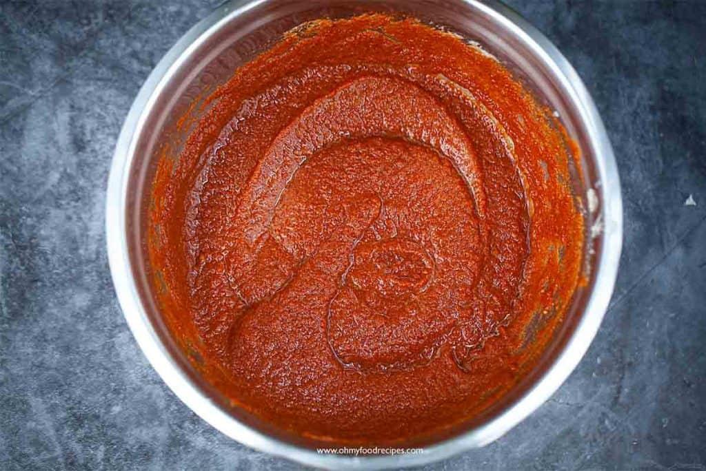 kimchi sauce in a sliver bowl