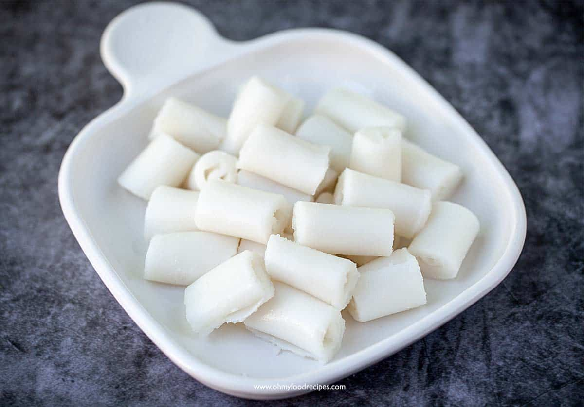 cheung fun or rice noodle rolls cut into pieces in a plate